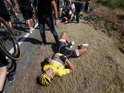 Race leader and yellow jersey holder Trek Factory rider Fabian Cancellara of Switzerland lies on the ground after a fall during the 159,5 km third stage of the 102nd Tour de France cycling race from Anvers to Huy, Belgium