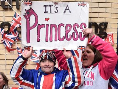 Royal fans celebrate outside the Lindo wing at St Mary's hospital in central London
