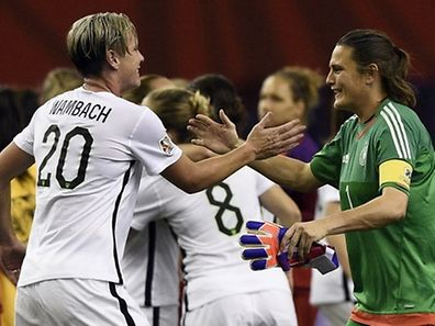 USA forward Abby Wambach (L) is congratulated by Germany's goalkeeper Nadine Angerer (R) at the end of their  semi-final football match of the 2015 FIFA Women's World Cup at the Olympic Stadium in Montreal on June 30, 2015. USA won 2-0.    AFP PHOTO / FRANCK FIFE