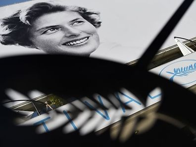 A picture taken on May 12, 2015, shows the festival's logo and the official poster of the 68th Cannes Film Festival, featuring Swedish actress Ingrid Bergman, on the Festival's palace facade in Cannes, southeastern France AFP PHOTO / LOIC VENANCE