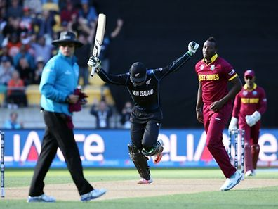 New Zealand's Martin Guptill celebrates scoring 200 runs during the Quarter Final Cricket World Cup match between New Zealand and the West Indies played at the Wellington Regional Stadium in Wellington on March 21, 2015.�AFP PHOTO / Michael Bradley