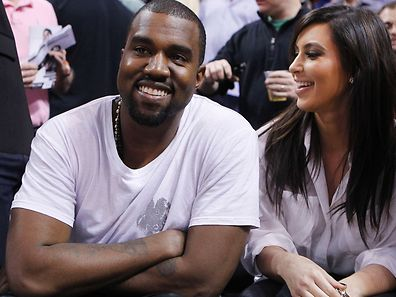 Rap musician Kanye West is seen court side with reality television star Kim Kardashian as the Miami Heat play the New York Knicks in their NBA basketball game in Miami, Florida December 6, 2012. REUTERS/Andrew Innerarity (UNITED STATES - Tags: SPORT BASKETBALL ENTERTAINMENT)