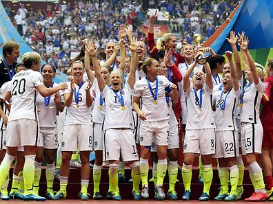 U.S team celebrates after their victory in the final football match against Japan