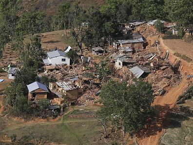 Earthquake victims work near their collapsed houses at a village in Sindhupalchowk, Nepal May 3, 2015. REUTERS/Adnan Abidi
