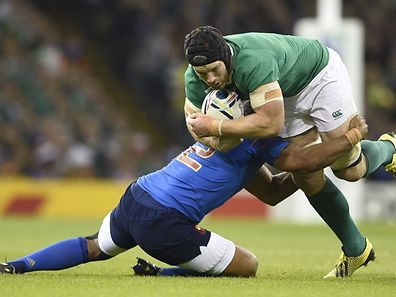 Ireland's flanker Sean O'Brien (R) is tackled by France's hooker Guilhem Guirado (L) during the Pool D match of the 2015 Rugby World Cup between France and Ireland at the Millennium Stadium in Cardiff, south Wales, on October 11, 2015. AFP PHOTO / DAMIEN MEYER