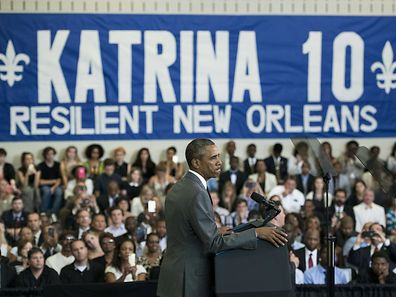 US President Barack Obama pauses while speaking about Hurricane Katrina at the Andrew P. Sanchez Community Center on August 27, 2015 in New Orleans, Louisiana. Obama is traveling to New Orleans to survey progress 10 years after Hurricane Katrina. AFP PHOTO/BRENDAN SMIALOWSKI