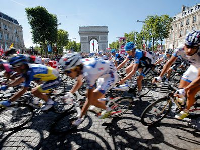 Cyclists pass the Arc de Triomphe during the 20th stage of the the Tour de France cycling race over 120 kilometers (74.6 miles) with start in Rambouillet and finish in Paris, France, Sunday July 22, 2012.