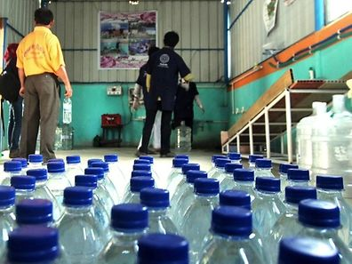 Charity workers have teamed with an impoverished village in eastern India to develop what they say is the world's cheapest bottle of drinking water - costing less than one US cent.