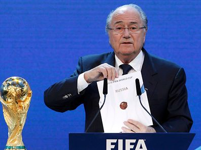 FIFA President Sepp Blatter announces Russia as the host nation for the FIFA World Cup 2018, in Zurich in this December 2, 2010 file picture. Swiss authorities have opened criminal proceedings against individuals on suspicion of mismanagement and money laundering related to the allocation of the 2018 and 2022 FIFA soccer World Cups in Russia and Qatar.   REUTERS/Christian Hartmann/Files