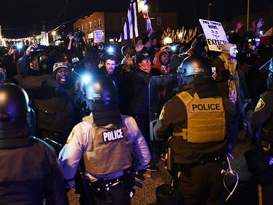 Police block protesters as they march on a street following the grand jury decision in the death of 18-year-old Michael Brown in Ferguson, Missouri, on November 24, 2014.