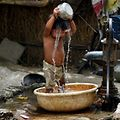 A young Indian child pours water on himself as he tries to cool himself off in New Delhi on May 28, 2015. More than 1,100 people have died in a blistering heatwave sweeping India, authorities said, as forecasters warned searing temperatures would continue. AFP PHOTO/MONEY SHARMA.