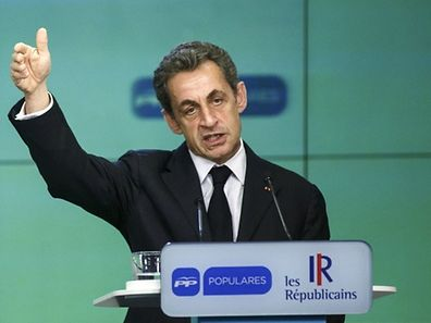 France's former President and head of the conservative Les Republicains party Nicolas Sarkozy gestures as he speaks during a joint news conference with Spanish Prime Minister Mariano Rajoy at the People's Party (PP) headquarters in Madrid, Spain, June 29, 2015.  REUTERS/Andrea Comas