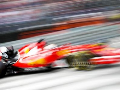 Ferrari Formula One driver Sebastian Vettel of Germany takes a curve during the first free practice session at the Monaco F1 Grand Prix May 21, 2015. REUTERS/Max Rossi