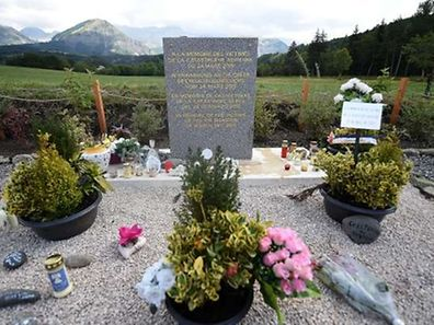 A picture taken on July 24, 2015 in Le Vernet, southern France, shows a stele in memory of the victims of the crash of the Germanwings plan