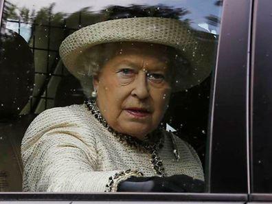 Britain's Queen Elizabeth leaves the annual Braemar Highland Gathering in Braemar, Scotland September 6, 2014.