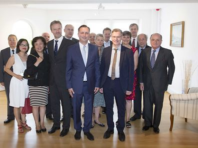 Bartosz Jalowiecki (front centre) and Finnish ambassador Timo Ranta (front right) with fellow international diplomats