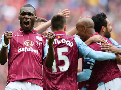 Aston Villa's Zaire-born Belgian striker Christian Benteke (L) celebrates Villa's second goal during the FA Cup semi-final between Aston Villa and Liverpool at Wembley stadium in London on April 19