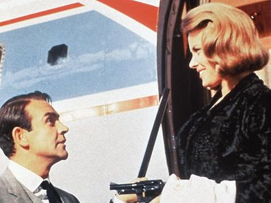 Pussy Galore (Honor Blackman)is charmed by James Bond (Sean Connery) in the film version of Goldfinger