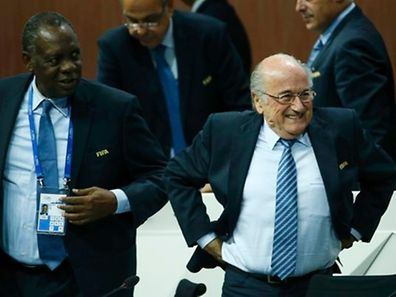 FIFA President Sepp Blatter (R) reacts after he was re-elected at the 65th FIFA Congress in Zurich, Switzerland, May 29, 2015.