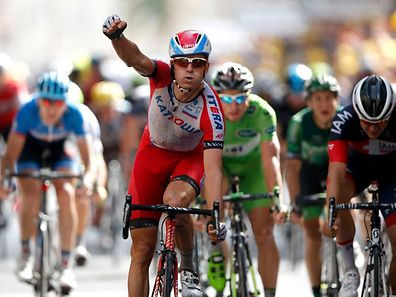 Katusha team rider Alexander Kristoff of Norway celebrates as he crosses the finish line to win the 222-km 15th stage of the Tour de France cycling race between Tallard and Nimes