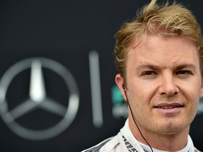 Mercedes AMG Petronas F1 Team's German driver Nico Rosberg walks into the paddock after the second practice session at the Silverstone circuit in Silverstone on July 2, 2015 ahead of the British Formula One Grand Prix.        AFP PHOTO / ANDREJ ISAKOVIC