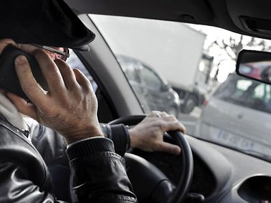 Using a mobile phone or a tablet while driving will cost 2 points and 145 euros as of June 1