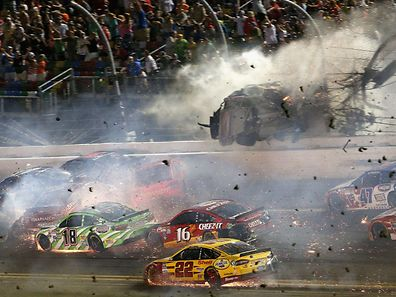 DAYTONA BEACH, FL - JULY 06: Austin Dillon, driver of the #3 Bass Pro Shops Chevrolet, is involved in an on-track incident following the checkered flag during the NASCAR Sprint Cup Series Coke Zero 400 Powered by Coca-Cola at Daytona International Speedway on July 6, 2015 in Daytona Beach, Florida.   Patrick Smith/Getty Images/AFP == FOR NEWSPAPERS, INTERNET, TELCOS & TELEVISION USE ONLY ==