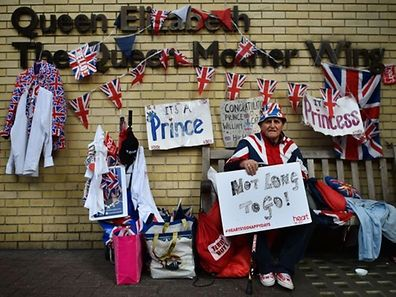 Royal fan Terry Hutt poses for pictures as he sits on a bench outside the Lindo Wing of St Mary's hospital in central London