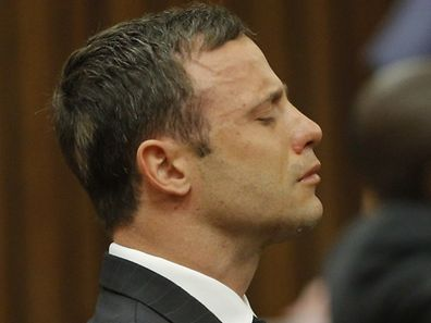South African paralympian athlete Oscar Pistorius listens on September 11, 2014 as a judge began at the High Court in Pretoria handing down her verdict on whether he was guilty of the 2013 Valentine's Day murder of his model girlfriend.
