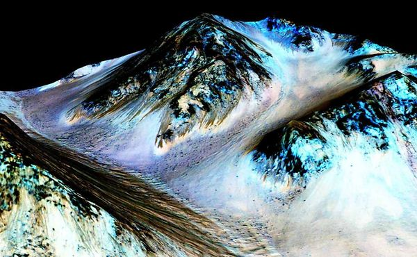 Dark, narrow, 100 metre-long streaks on Mars inferred to have been formed by contemporary flowing water are seen in an image produced by NASA
