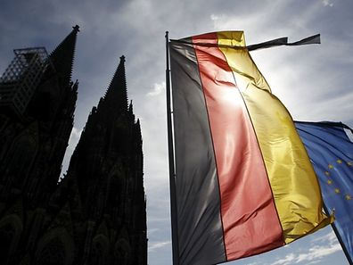 Flags of Germany and the EU fly with black ribbons during a memorial service for the 150 victims of Germanwings flight 4U 9525 in Cologne's Cathedral, April 17, 2015. Germany holds a state ceremony at Cologne cathedral to remember the dead killed in the March 24 Germanwings plane crash in the French Alps.         REUTERS/Ina Fassbender    TPX IMAGES OF THE DAY