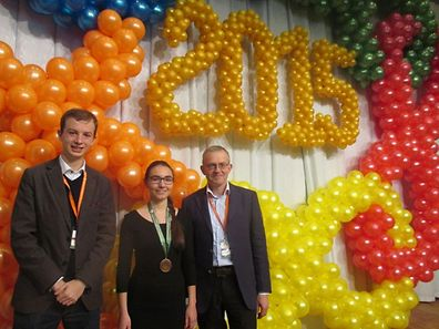 "From left to right: head of the Luxembourg EGMO team, Pierre Haas, student of the ""Lycée Robert-Schuman"" and bronze winner, Tara Trauthwein, Charles Leytem, member of the organising committee of the EGMO 2015"
