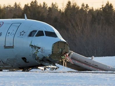 The safety chute is deployed behind the damaged nose of the Airbus A320 that slid off a runway at the end of Air Canada Flight 624 at Halifax Stanfield Airport in Enfield, Nova Scotia, March 29, 2015. The plane that suffered heavy damage in an accident in the east coast city of Halifax on Sunday landed short of the runway and hit an antenna array, losing its landing gear, safety officials said. No one was killed in the accident that sent more than 20 passengers and crew to hospital. All but one of those treated had been released by later in the day, the airline said.    REUTERS/Mark Blinch