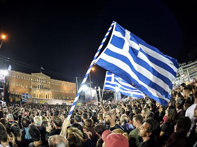 Thousands on 'NO' protesters gather in front of the parliament building in Athens on July 3, 2015. Greek Prime Minister Alexis Tsipras was cheered wildly as he arrived Friday for the rally in Athens' Syntagma Square, two days before a crucial bailout referendum. AFP PHOTO / ANDREAS SOLARO