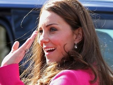 Britain's Catherine, Duchess of Cambridge waves as she leaves after a visit to the XLP Mobile Recording Studio on March 27, 2015 in south London. In 2008 XLP, EMI, MTV and the Met Police collaborated to create the X-Mobile studio. Converted from an old police riot van as part of MTV�s �Pimp My Ride� TV show this superbly equipped mobile recording studio has since been working in schools, pupil Referral Units and on estates. AFP PHOTO / CHRIS JACKSON / POOL
