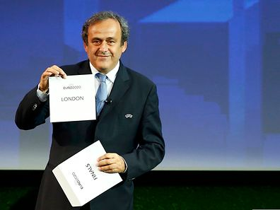 UEFA President Michel Platini shows the name of London after it was chosen to host the finals of Euro 2020 during a ceremony in Geneva on September 19