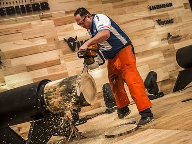 Marc Hermes of Luxemburg performs during the qualification of the Stihl Timbersports World Championship at the Olympiahall in Innsbruck, Austria on November 13, 2014.