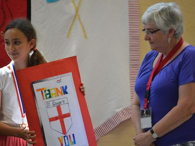 Heather Duxbury is presented with a thank you card