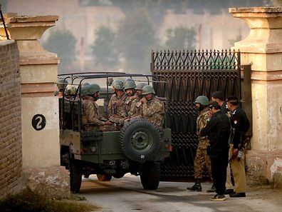 Pakistani army soldiers in a vehicle arrive at the gates of a school in Peshawar on December 17, 2014,