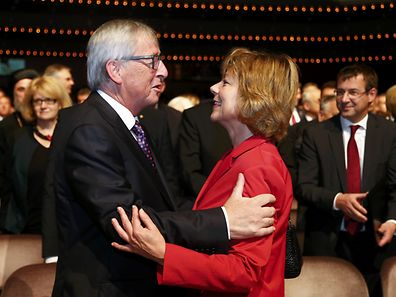 European Commission President Jean-Claude Juncker (L) embraces Daniela Schadt, partner of German President Joachim Gauck  at a ceremony in the 'Alte Oper' in Frankfurt / Main, Germany, on October 3, 2015. Germany on Saturday celebrated 25 years since its joyful reunification, with its leaders urging the country to muster the same strength and solidarity to face a record refugee influx.   AFP PHOTO / POOL / RALPH ORLOWSKI