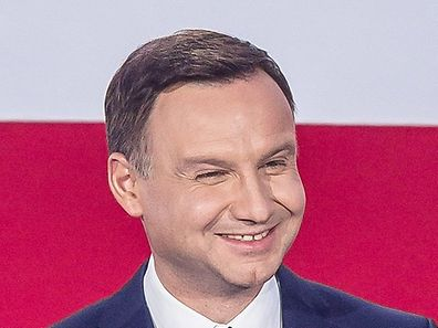 Andrzej Duda, presidential candidate of Law and Justice (PiS) right wing opposition party delivers a speech after the announcement of the exit poll results of the second round of the presidential election in Warsaw, on May 24, 2015. Conservative opposition challenger Andrzej Duda won Poland's cliffhanger presidential run-off, trumping centrist incumbent Bronislaw Komorowski, according to an exit poll by the TVP public broadcaster. AFP PHOTO/WOJTEK RADWANSKI