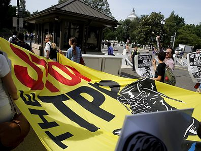 A small group of protestersdemonstrate against the Trans-Pacific Partnership (TPP) trade agreement on Capitol Hill