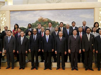 China's President Xi Jinping (c.) with guests at the Asian Infrastructure Investment Bank launch ceremony in Beijing, October 24, 2014