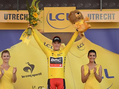 Australia's Rohan Dennis celebrates his overall leader yellow jersey on the podium at the end of the 13.8 km individual time-trial, the first stage of the 102nd edition of the Tour de France