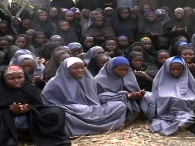 A screen grab taken on May 12, 2014, from a video of Nigerian Islamist extremist group Boko Haram showing 276 Nigerian schoolgirls, who were abducted from the northeastern town of Chibok in Borno