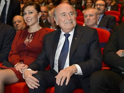 FIFA President Sepp Blatter and his girlfriend Linda Barras attend the opening ceremony of the 65th FIFA Congress in Zurich on May 28, 2015. UEFA president Michel Platini confronted FIFA leader Sepp Blatter on Thursday and called on him to stand down because of corruption scandals engulfing world football. Blatter refused and Platini made a public appeal for member nations to vote against Blatter for the FIFA presidency in an election on May 29.  AFP PHOTO / FABRICE COFFRINI