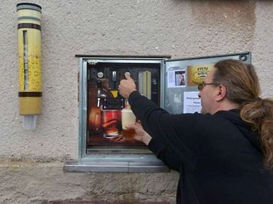 Martin Povysil, 50 year old former salesman for a medium-sized Czech brewery drafts a beer from his mechanic self-service pub