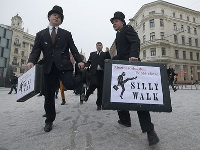Fans of the British comedy group Monty Python perform their skills during the International Silly Walk Day