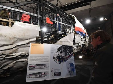 The wrecked fuselage of the Malaysia Airlines flight  MH17 is presented to the press during a presentation of the final report on the cause of its crash
