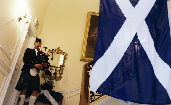 A piper welcomes guests to the British Embassy Residence in Luxembourg